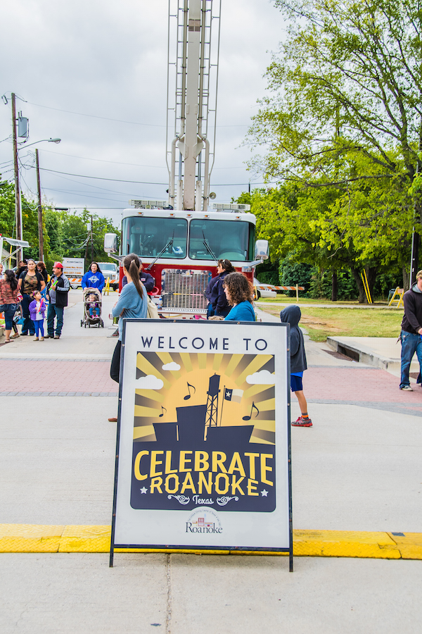 Celebrate Roanoke sign in front of firetruck